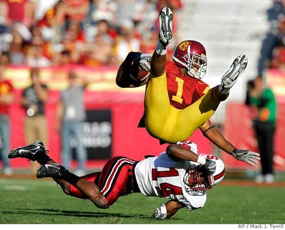 Southern California wide receiver Patrick Turner is upended by Stanford cornerback Tim Sims during the first half of a football game Saturday, Oct. 6, 2007, in Los Angeles. (AP Photo/Mark J. Terrill) Photo: Mark J. Terrill