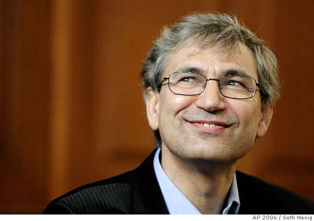 Turkish novelist Orhan Pamuk appears at a news conference in New York, Thursday, Oct. 12, 2006. Pamuk, an international symbol of literary and social conscience, whose poetic, melancholy journeys into the soul of his native Turkey have brought him the many blessings and burdens of public life, won the Nobel literature prize Thursday. (AP Photo/Seth Wenig)  Ran on: 10-13-2006 Ran on: 10-13-2006 Photo: SETH WENIG