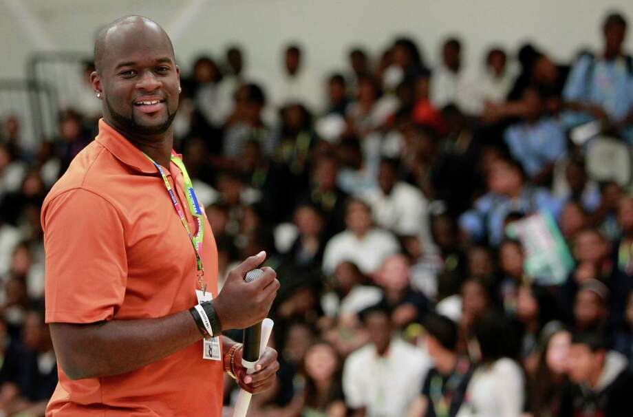 Vince Young participates in a pep rally at Sterling High School designed to encourage high school students go to college on Friday, May 20, 2011, in Houston.  Generation TX and Vince Young Foundation unite to inspire high school students to reach higher education. Photo: Mayra Beltran, Houston Chronicle / © 2011 Houston Chronicle
