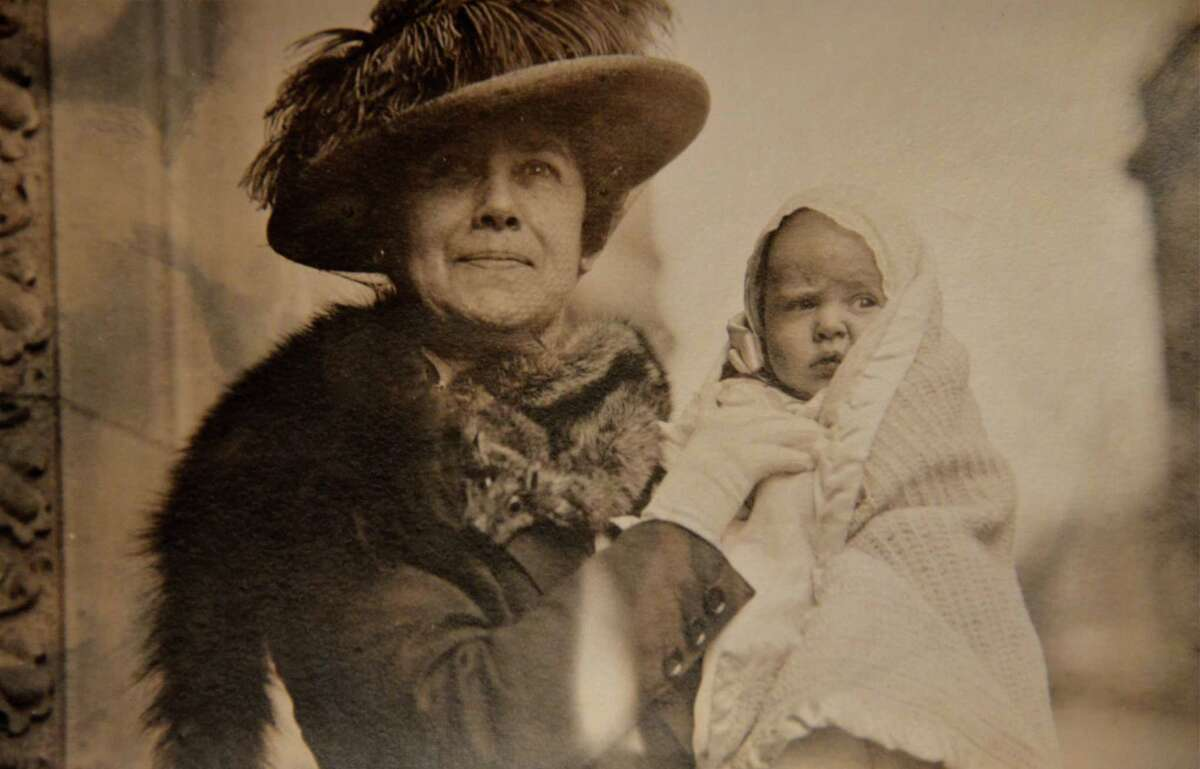 Helen Churchill Candee holds one of her grandchildren, circa 1917. Candee, who grew up in New Haven and Norwalk, survived the 1912 sinking of the Titanic. An exhibition focused on her life, of which her Titanic survival was just part of the story, opens at Norwalk's Lockwood-Mathews Mansion Museum on Wednesday, April 25. A gala preview is planned for Saturday, April 21. Contributed photo/Jennifer Rose