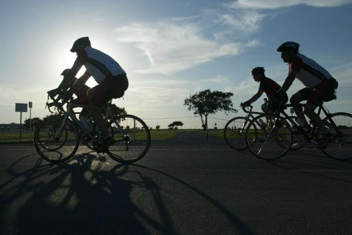 1. FORT WORTH Bicycle riders are silhoutted during the Ride of Silence at Texas Motor Speedway Wednesday, May 17, 2006. (RAUL VASQUEZ / AP)