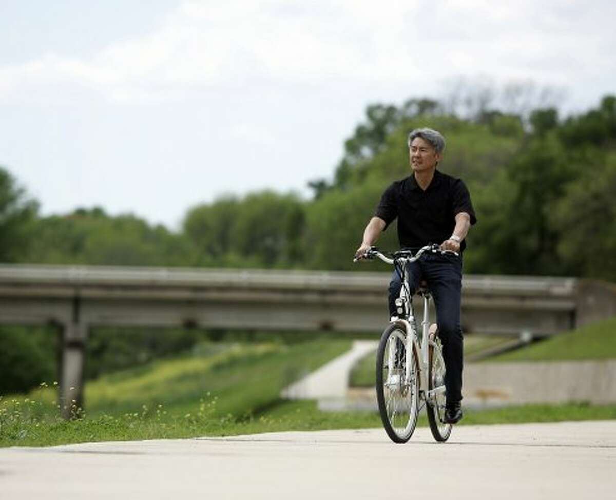 1. FORT WORTH Paul Jung, co-founder/president of Bodhi bicycles rides an electric bike at Trinity Trails in Fort Worth, Texas, March 22, 2011. (Bob Booth / McClatchy-Tribune News Service)