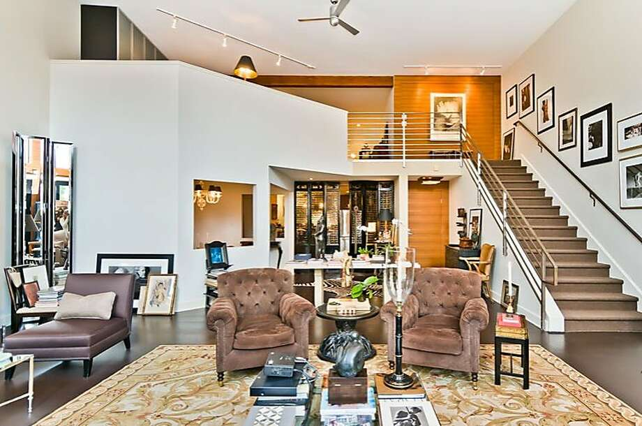 The largest of the six units in the building, this condo has dramatic 18-foot ceilings. Photo: Olga Soboleva