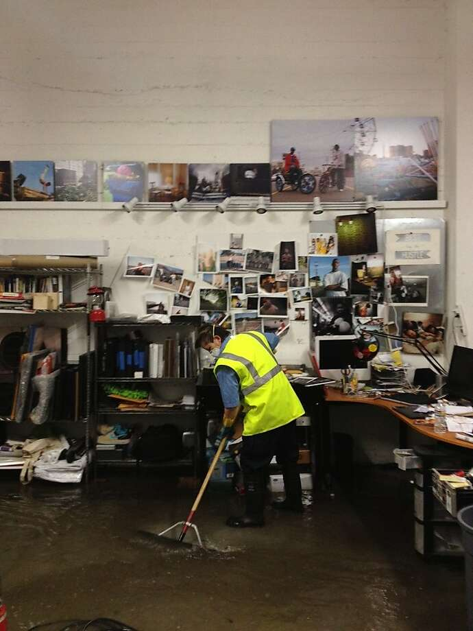 Employees for Servicemaster Clean try to remove water from studios at Workspace, located on Folsom between 17th and 18th streets in San Francisco after heavy rain flooded the area on Thursday, April 12, 2012. Photo: Jason Henry, Special To The Chronicle