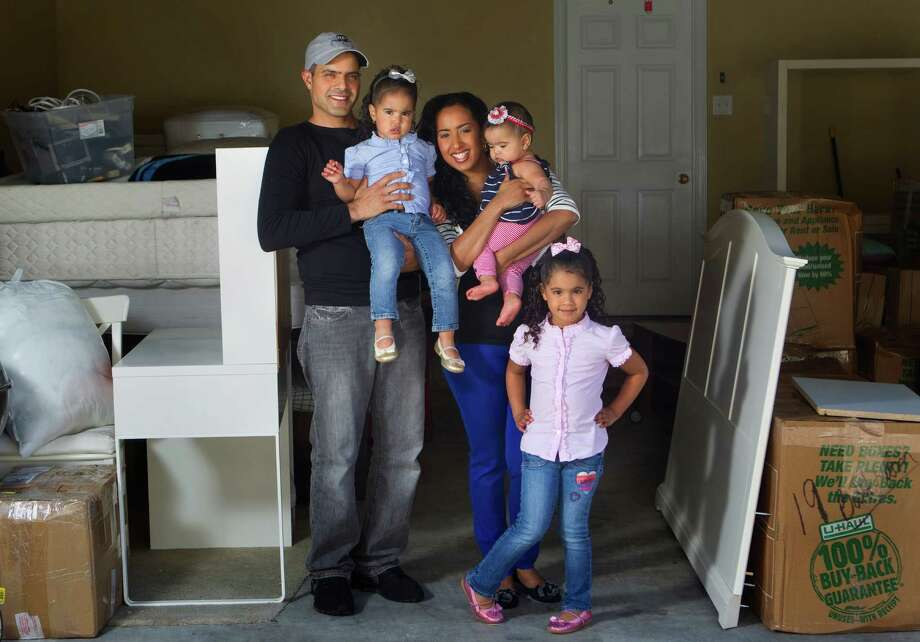 From left to right, Yaniv Nagar, Doriann Nagar, 2, Ysabel Nagar, Shaili Nagar, 7 months, and Eliyah Nagar, stand in their garage Saturday, March 24, 2012, in Houston. The family is Jewish and has sold their belongings, quit their jobs and on Monday are moving to Israel to live permanently. (Cody Duty / Houston Chronicle) Photo: Cody Duty / © 2011 Houston Chronicle