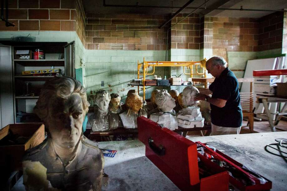 David Adickes looks at the initial busts he created for the larger presidential concrete heads in the basement at the old Huntsville High School which was converted into the Adickes Art Foundation Museum, Wednesday, April 11, 2012, in Huntsville. Photo: Michael Paulsen, Houston Chronicle / © 2012 Houston Chronicle