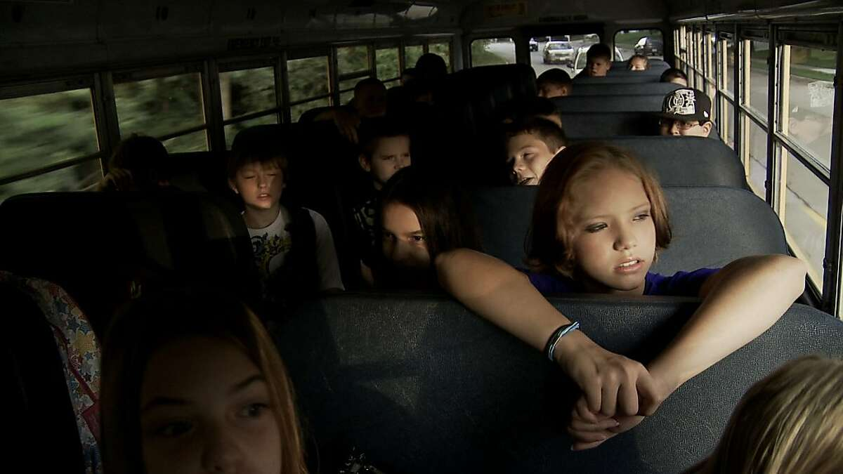 Children on a school bus are seen in,
