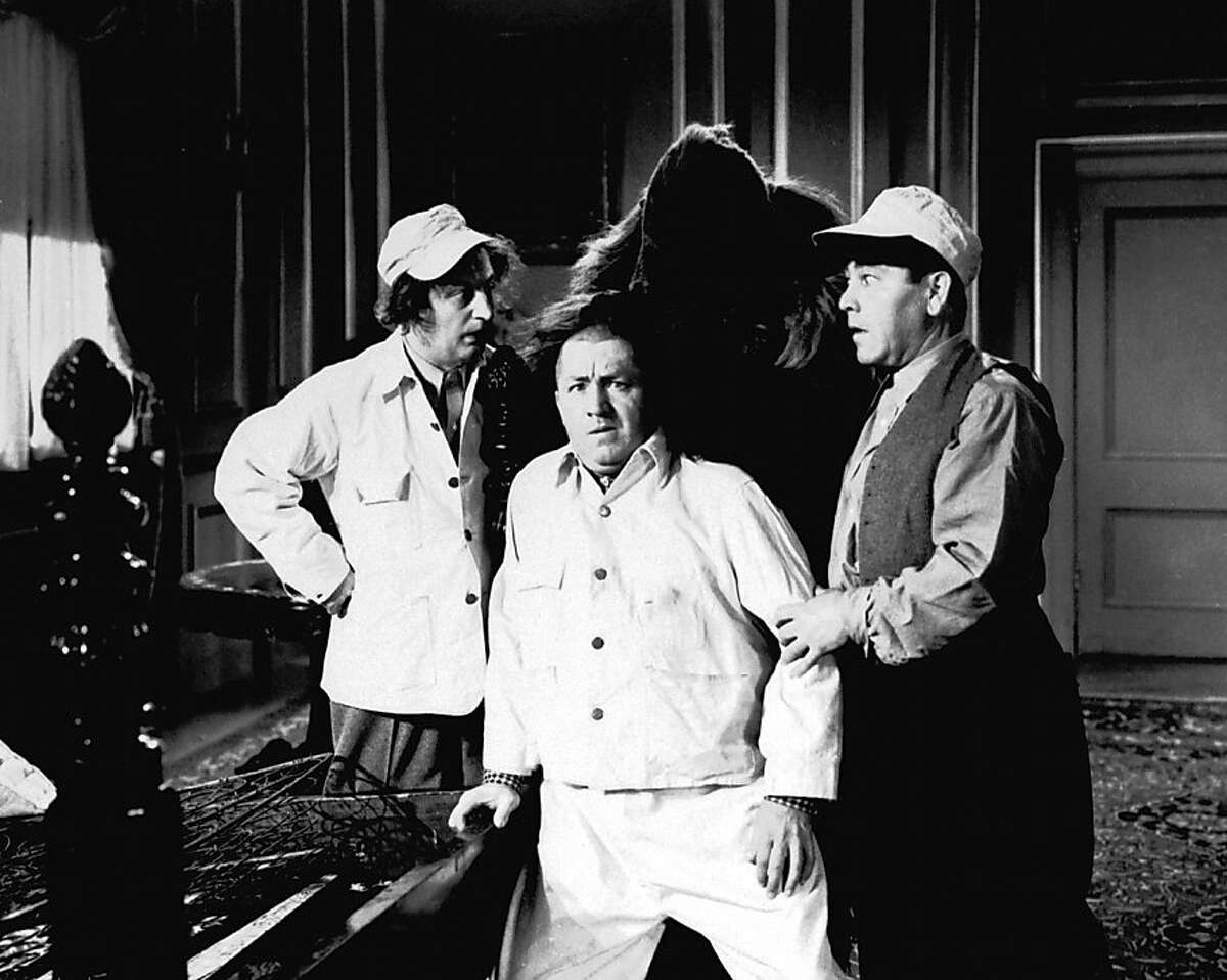 """In this undated image originally released by Columbia Pictures, from left, Larry Fine, Curly Howard and Moe Howard are shown in a scene from a """"The Three Stooges,"""" film. Filmmakers Peter and Bobby Farrelly have created a remake of the popular comedy trio starring Sean Hayes, Will Sasso and Chris Diamantopoulos. (AP Photo/Columbia Pictures)"""