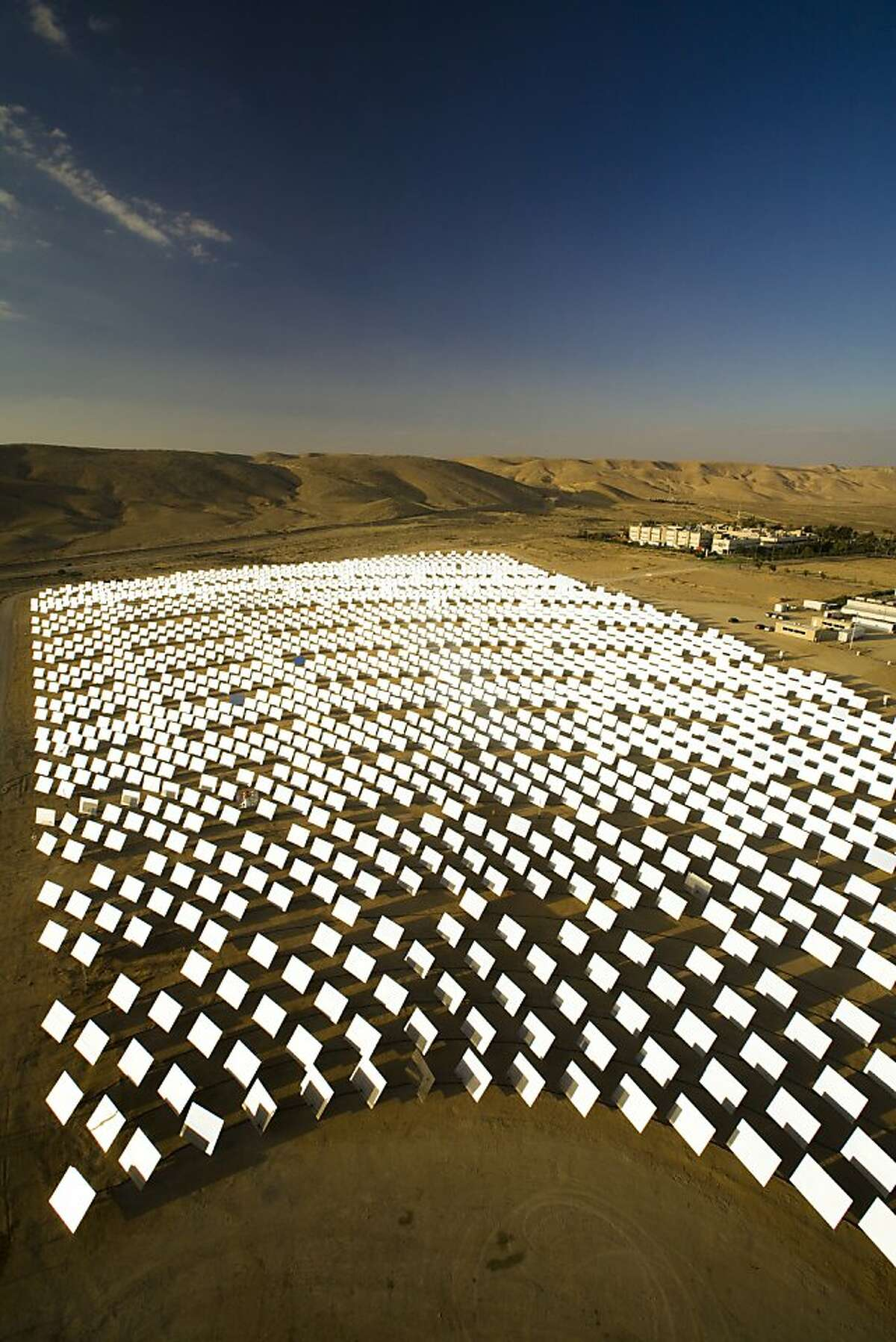 Sunlight bounces off mirrors at BrightSource Energy's solar plant in Israel's Negev Desert on Nov. 11, 2008.