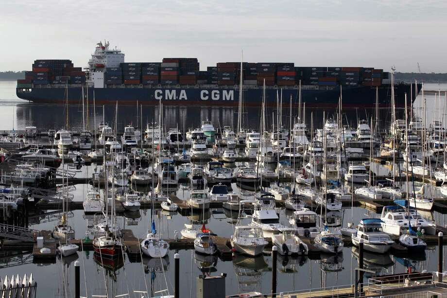 The CMA CGM container ship Georgia sails into Charleston Harbor past a marina in Mount Pleasant, S.C. U.S. exports are up, and the trade deficit fell in February 2012 to the lowest point in four months. Photo: Matt Rourke / AP2012