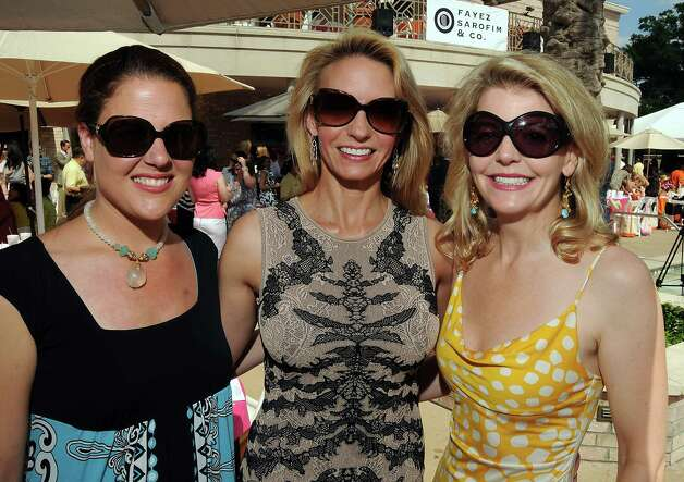 From left: Liz Moriarty, Connie Turner and Michelle Foutch at the River Oaks Country Club's Tennis Tournament Luncheon and Fashion Show Wednesday April 11,2012. (Dave Rossman/ For the Chronicle) Photo: Dave Rossman / © 2012 Dave Rossman