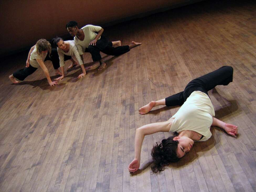 Dancers perform during of a work in progress in emergent improvisiton by Susan Sgorbati. (Jake Meginsky)