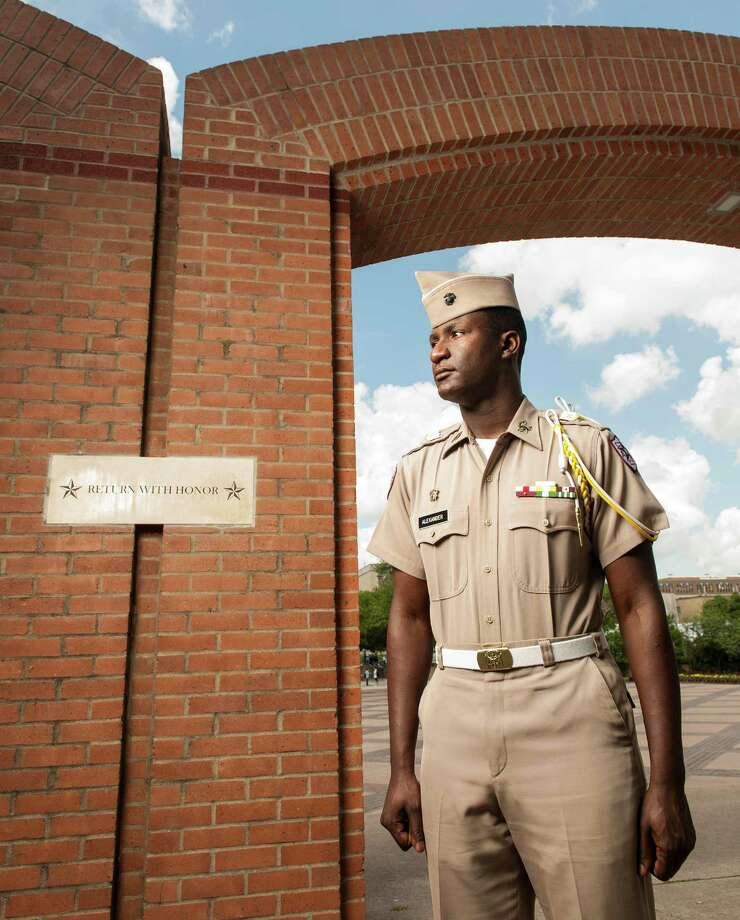 Texas A&M junior Marquis Alexander poses for a photograph by the Corps Arches, the entry point to the Corps of Cadets residence halls, on the A&M campus, Wednesday, April 11, 2012, in College Station, Texas. Alexander has been appointed to Corps Commander, the top leadership position for the A&M Corps of Cadets, for the next year. (AP Photo/Dave Einsel) Photo: Dave Einsel, FRE / FR43584 AP