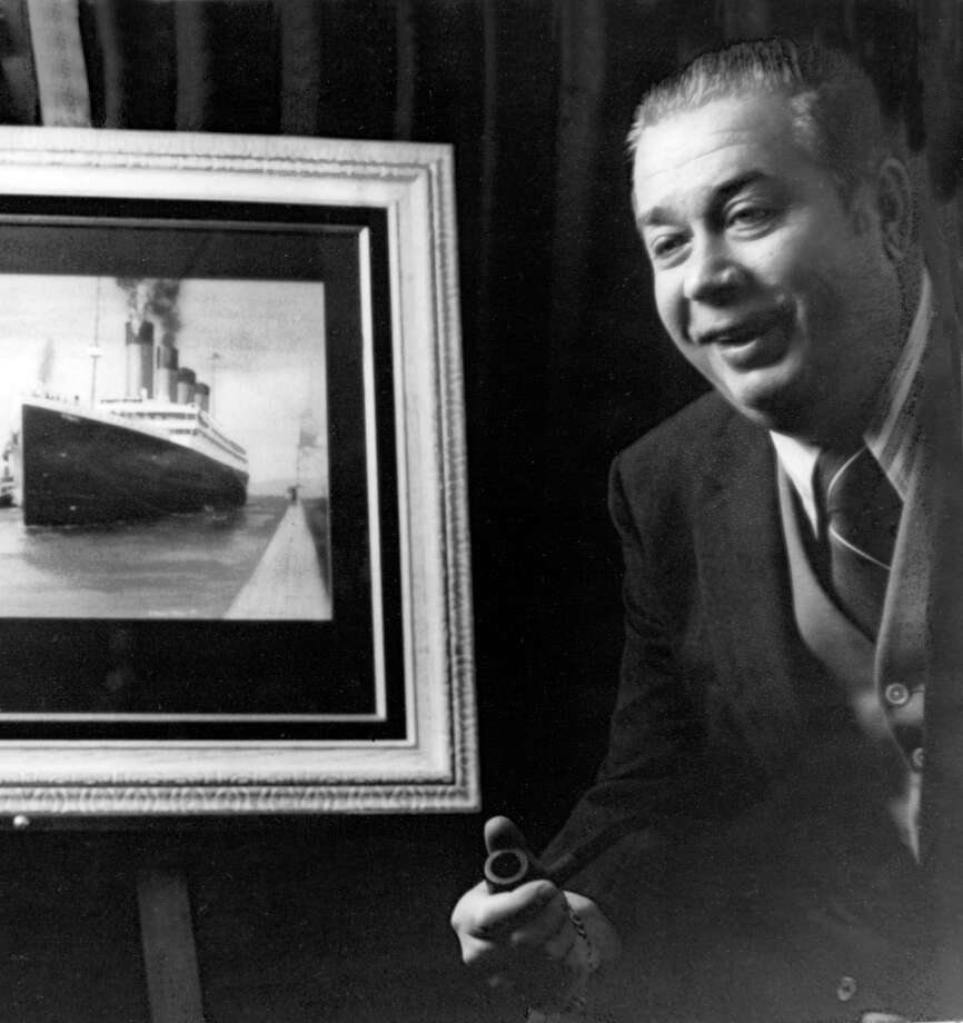William Tantum IV, a Riverside resident known as Mr. Titanic for his role in spreading the story of the RMS Titanic, is pictured in an undated photograph beside a framed picture of the doomed ship. The ship struck an iceberg and sank on April 15, 1912. Tantum died at the age of 49 in 1980, five years before his friend, oceanographer Robert Ballard, led the team that discovered the ship. Photo courtesy of the Titanic Historic Society. Photo: Contributed Photo