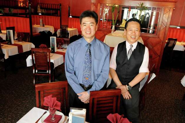 Owner Jeff Chen, left, and floor manager Eddie Chan on Tuesday, April 10, 2012, at the Pacific Grill in Saratoga Springs, N.Y. (Cindy Schultz / Times Union) Photo: Cindy Schultz / 00017151A
