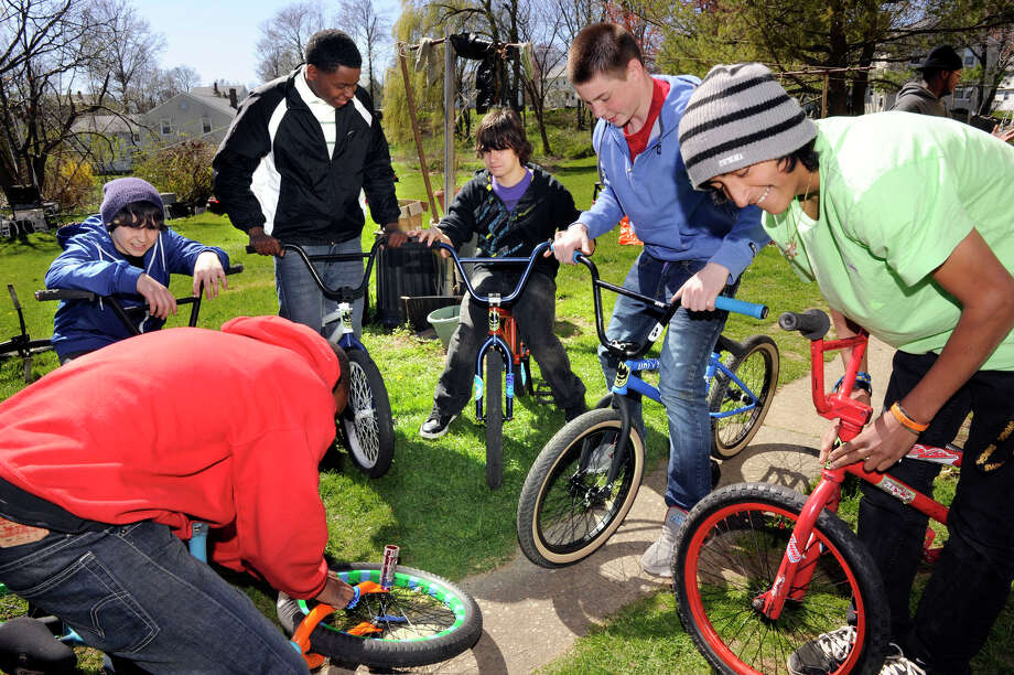Friends and fellow BMXers get ready for a bike ride to downtown Danbury Friday afternoon. from left are, Yorman Hernandez, (bending) 18, Kevin Snyder, 13, Shakiem Guyton, 14, Josh Gilligan, 16, Will Coffey, 15, and Andy Mora, 16. The boys were starting outside the Hernandez home on Mill Ridge Road in Danbury, Friday, April 6, 2012. Photo: Carol Kaliff