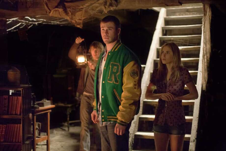 """Fran Kranz, from left, Chris Hemsworth and Anna Hutchison star in """"The Cabin in the Woods."""" Photo: Diyah Pera / Lionsgate"""