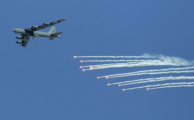 A B-52 drops 500-pound bombs and flares during a U. S. Air Force firepower demonstration on  Sept. 14, 2007 at the Nevada Test and Training Range near Indian Springs, Nev. Photo: Ethan Miller, Getty Images / 2007 Getty Images