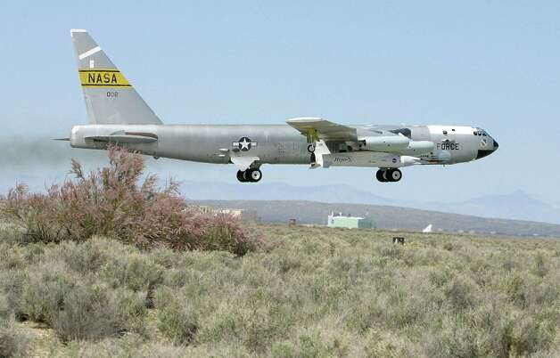 A B-52 takes off with the experimental NASA X-43A attached on March  27, 2004 from Edwards Air Force Base in California. During this flight, the X-43A reached Mach 6.8,  setting a short-lived speed record. Photo: ROBYN BECK, AFP/Getty Images / 2004 AFP