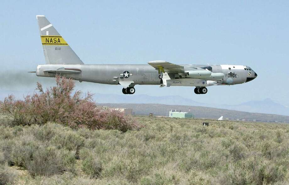 A modified NASA B-52 bomber with the experimental X-43A attached under its right wing takes off from Edwards Air Force Base in California's Mojave Desert on March 27, 2004. Photo: ROBYN BECK, AFP/Getty Images / 2004 AFP