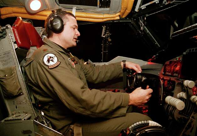 """A U.S. Air Force major with the call sign """"Ponch,"""" a pilot instructor, flies a B-52 bomber training mission in a simulator March 5, 2003 at Barksdale Air Force Base in Louisiana. Photo: Mario Villafuerte, Getty Images / 2003 Getty Images"""