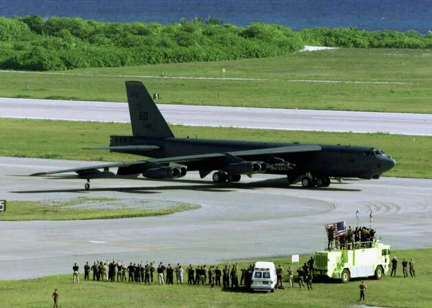 U.S. Air Force personnel wave at a B-52H Stratofortress bomber as it taxis for take off on a strike mission against al Qaeda terrorist training camps and military installations of the Taliban regime October 7, 2001 in an unknown location. Photo: USAF, Getty Images / Getty Images North America