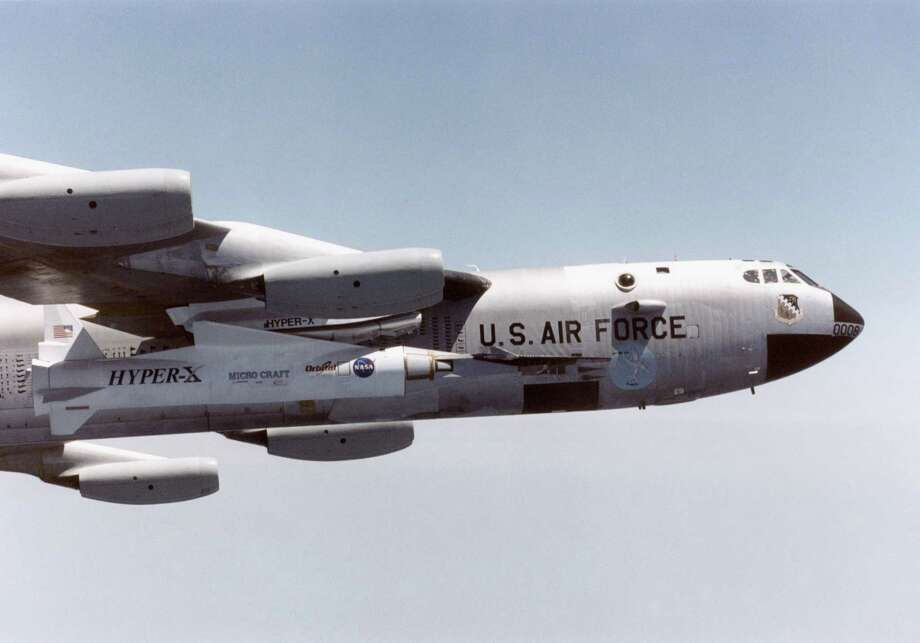 A NASA B-52 aircraft flies with the X-43A hypersonic research vehicle and its Pegasus booster rocket mounted beneath its wing April 28, 2001 above the Pacific Missile Test Range off the coast of California. Photo: NASA, Getty Images / Getty Images North America