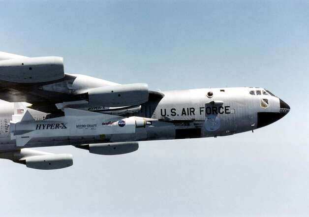 NASA's first X-43A Hypersonic Experimental Vehicle is shown mated to the wing of the B-52 launch platform in flight in an undated  photo. The first X-43A was destroyed during its maiden flight on June 2, 2001, after a booster rocket carrying it aloft veered out of control and tumbled from the sky. Photo: NASA, Getty Images / Getty Images North America