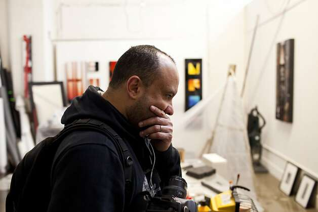 Photographer and artist Igor Capibaribe reacts to the damage to his studio at Workspace Limited Studios after he lost many of his pieces after early Thursday morning rain flooded many businesses and homes on Folsom Street in between 17th and 18th streets in San Francisco, Calif., April 12, 2012. Workspace was scheduled to have open studios Friday but many of the artists work on the ground floor was damaged by the flooding. Photo: Jason Henry, Special To The Chronicle