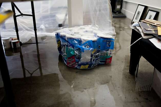 A package of paper towels floats in photographer and artist Igor Capibaribe's studio at Workspace Limited Studios after early Thursday morning rain flooded many businesses and homes on Folsom Street in between 17th and 18th streets in San Francisco, Calif., April 12, 2012. Workspace was scheduled to have open studios Friday but many of the artists work on the ground floor was damaged by the flooding. Photo: Jason Henry, Special To The Chronicle