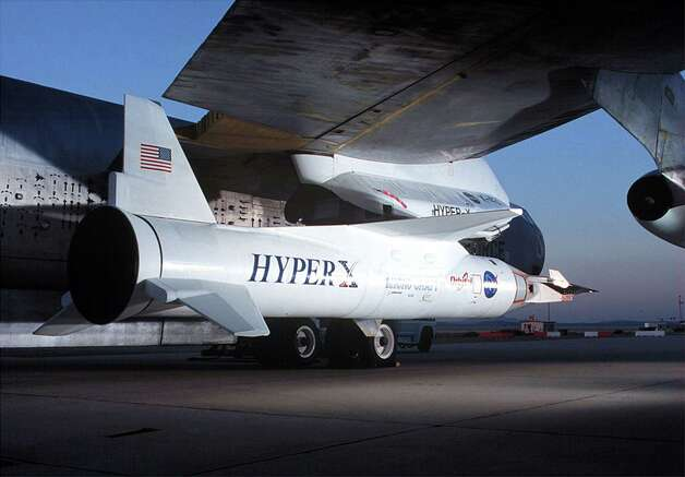 NASA's X-43A Hypersonic  Experimental Vehicle is mated to the wing of the B-52 launch platform in an undated photo. The first X-43A was destroyed during its maiden flight on June 2, 2001,  after a booster rocket carrying it aloft veered out of control and tumbled from the sky. Photo: NASA, Getty Images / Getty Images North  America