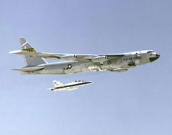 A B-52 bomber is accompanied by an F/A-18 fighter in this undated photo. Photo: Getty Images / Getty Images North America