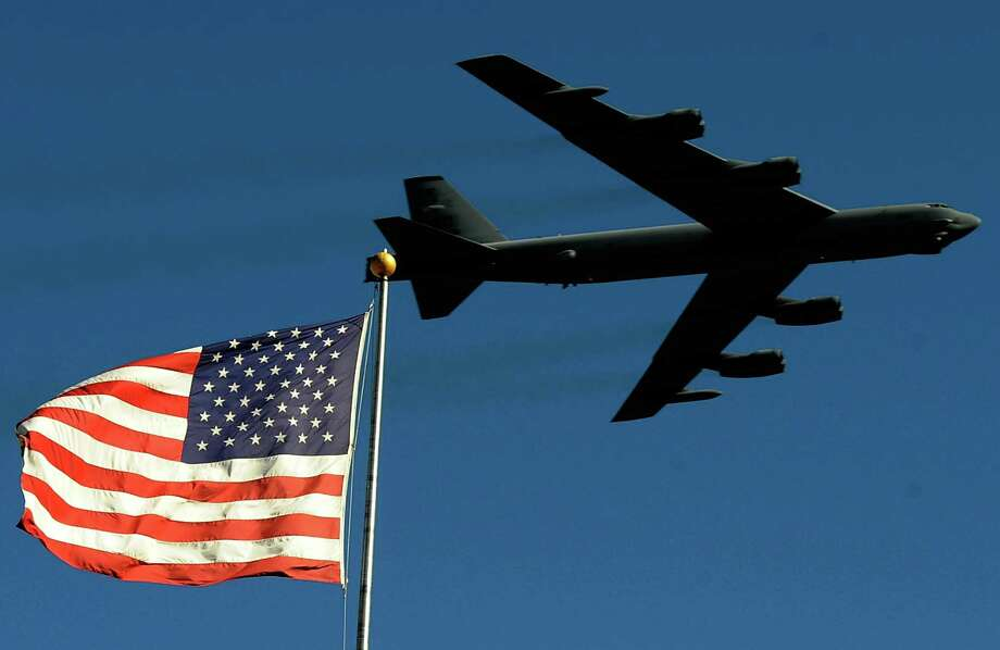 A B-52 from the 93rd Bomb Squadron, Barksdale Airforce Base, performs a flyover during pre-race ceremonies prior to the NASCAR Sprint Cup Series AAA Texas 500 at Texas Motor Speedway on November 7, 2010 in Fort Worth, Texas. Photo: Rusty Jarrett, Getty Images For NASCAR / 2010 Getty Images