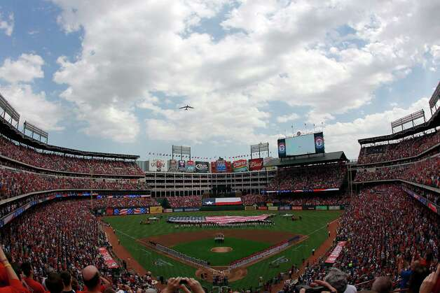 A B-52 flies over the Rangers Ballpark in Arlington during Opening Day on April 1, 2011 in Arlington, Texas. Photo: Tom Pennington, Getty Images / 2011 Getty Images