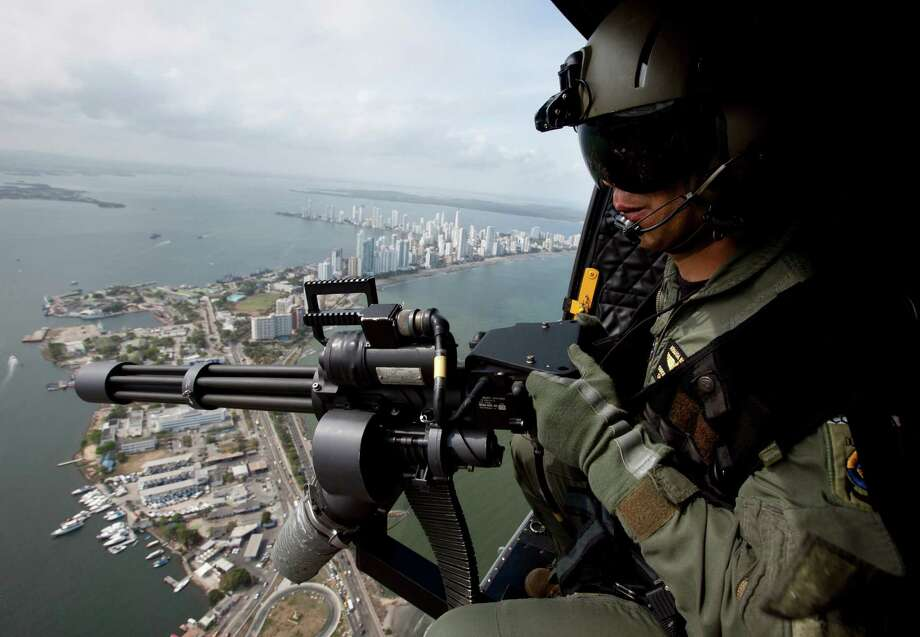 A navy helicopter patrols Thursday over Cartagena, Colombia. Thirty-three of 35 Western Hemisphere leaders will gather for the sixth Summit of the Americas in the colonial-era port this weekend. Photo: Fernando Vergara / AP