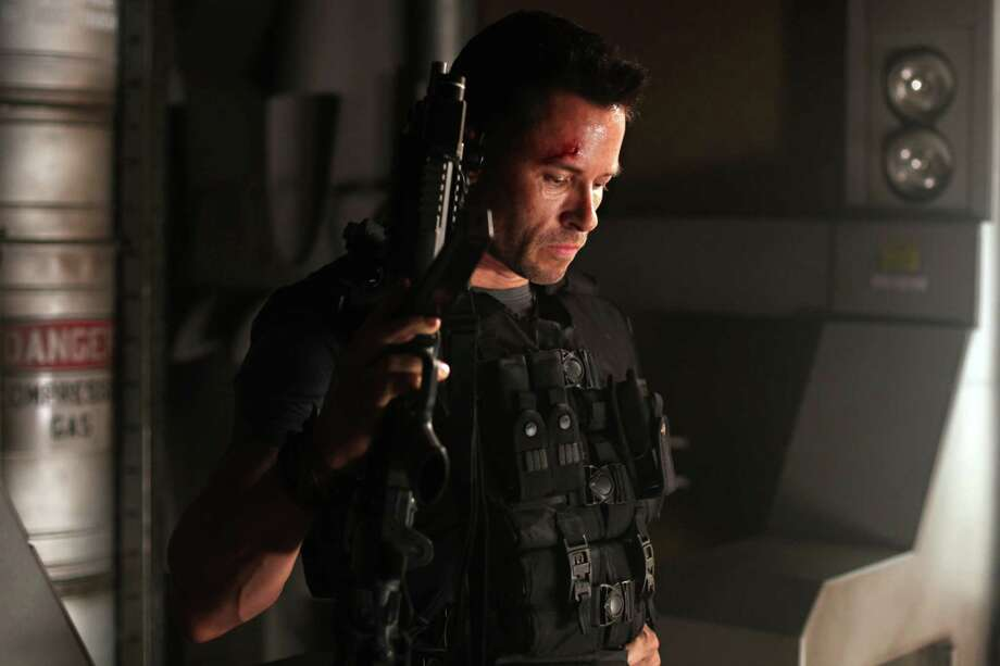 """In this film image released by Film District, Guy Pearce is shown in a scene from """"Lockout."""" (AP Photo/Film District) / Film Disctrict"""