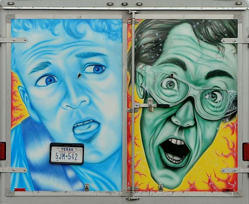 A pair of faces painted on the back of a trailer appear along U.S. Highway 59 North Wednesday, April 11, 2012, in Lufkin, Texas. (AP Photo/The Lufkin Daily News, Joel Andrews)