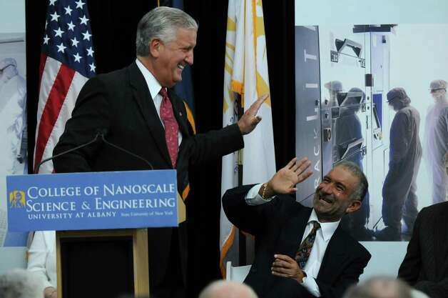 Albany Mayor Jerry Jennings, left, and College of Nanoscale Science and Engineering Senior Vice President and CEO Dr. Alain Kaloyeros, right, laugh during an event to announce that the state DOT will begin highway improvements at the intersection of Fuller Road and Washington Avenue Extension, at the Albany NanoCollege on Thursday April 12, 2012 in Albany, NY. (Philip Kamrass / Times Union ) Photo: Philip Kamrass / 00017221A