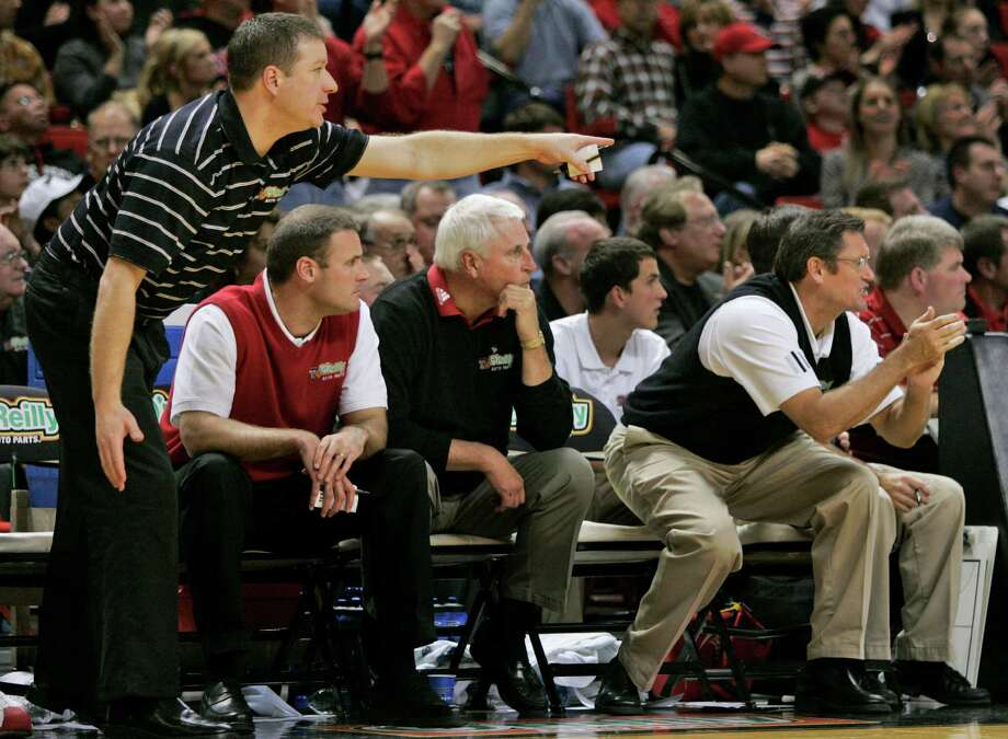 From left to right, Texas Tech assistant coach Chris Beard, and Pat Knight, head coach Bob Knight, Bubba Jennings, and Tim Knight keep an eye on their team during the first half of their basketball game with UNLV in Lubbock, Texas, Thursday, Dec. 28, 2006.(AP Photo/Tony Gutierrez) Photo: Tony Gutierrez, STF / AP2006