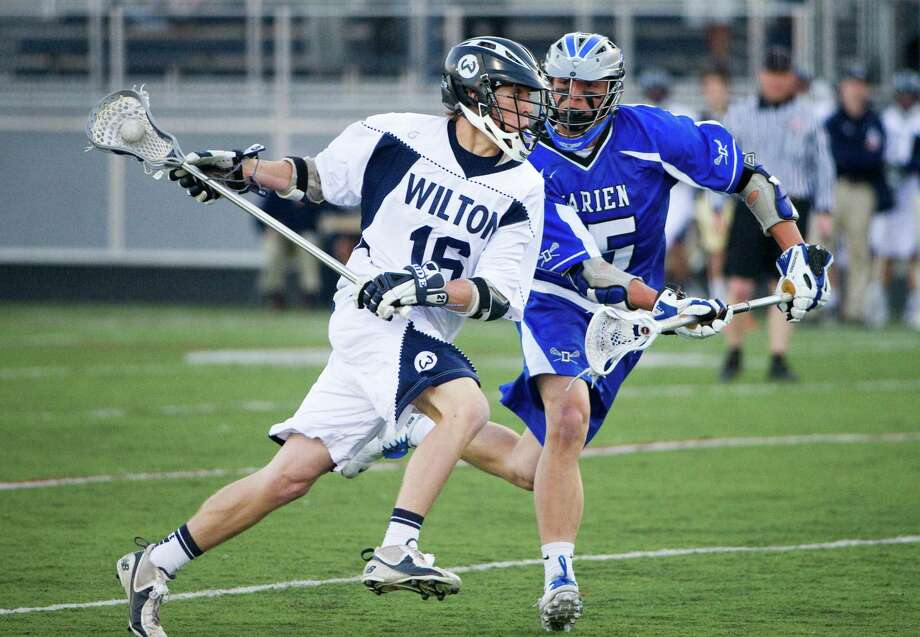 Wilton's Michael Burns and Darien's CJ Raia in action as Wilton High School hosts Darien in a boys lacrosse game in Wilton, Conn., April 12, 2012. Photo: Keelin Daly / Stamford Advocate