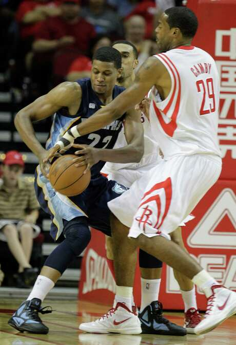 Memphis Grizzlies' Rudy Gay and Houston Rockets' Marcus Camby tangle for the ball during the third quarter of NBA game at Toyota Center Friday, March 30, 2012, in Houston.  ( Melissa Phillip / Houston Chronicle ) Photo: Melissa Phillip / © 2012 Houston Chronicle