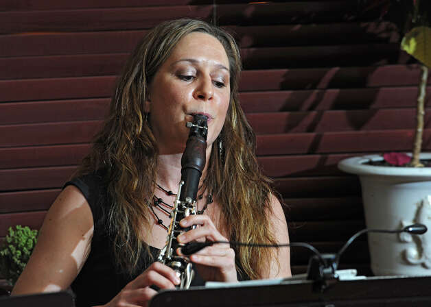 Michele Von Haugg performs on Wednesdays at Capriccio's restaurant in Saratoga Springs to spread the word about Clarinets for Conservation. She is traveling to Tanzania in May for the second time to teach students there about music and conservation. March 21, 2012. (Lori Van Buren / Times Union) Photo: Lori Van Buren