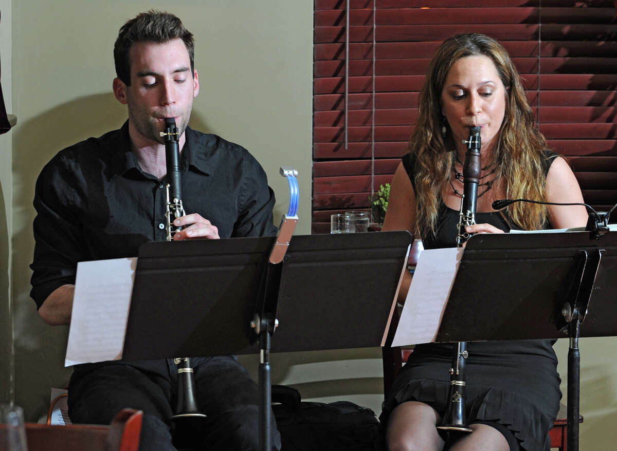Scott Horsington and Michele Von Haugg play clarinets for patrons at Capriccio's restaurant in Saratoga Springs. Von Haugg founded Clarinets for Conservation, and she and Horsington will travel to Tanzania in May to teach students there about music and conservation. March 21, 2012. (Lori Van Buren / Times Union)