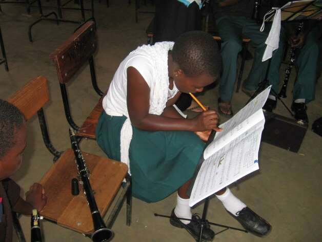 In 2010, Michele Von Haugg traveled to Tanzania to teach students to play the clarinet and learn about their threatened national tree, the mpingo, from which clarinets and other musical instruments are made. (Courtesy of Clarinets for Conservation)