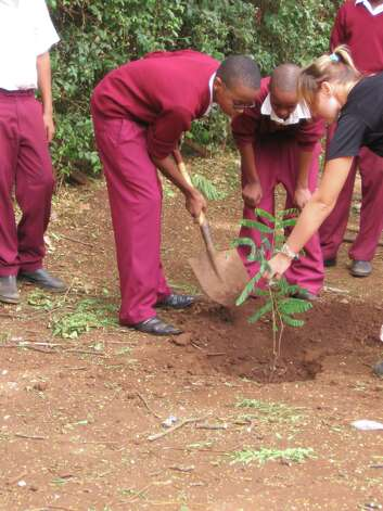 In 2010, Michele Von Haugg traveled to Tanzania to teach students to play the clarinet and learn about their threatened national tree, the mpingo, from which clarinets and other musical instruments are made. With the help of local conservationists, the students planted trees around their school. (Courtesy of Clarinets for Conservation)
