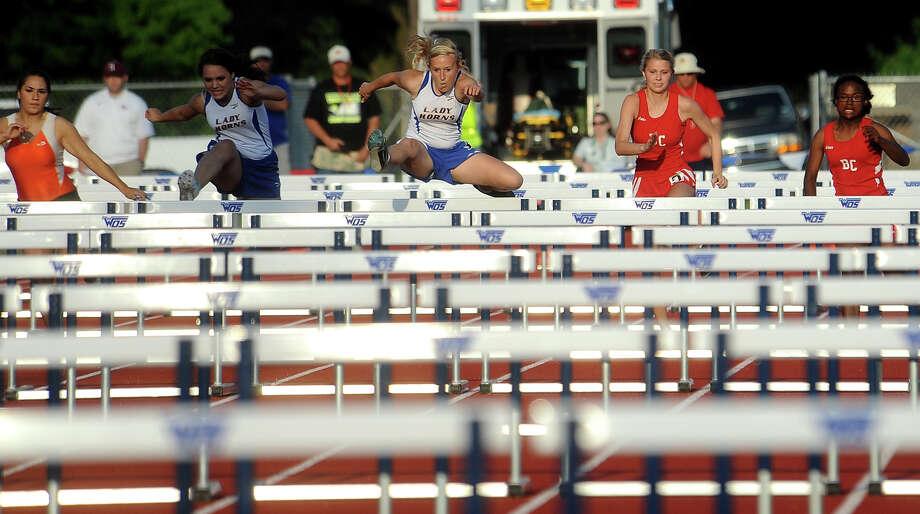 Hamshire-Fannett's Brandee Meguess (center) wins the the Girls 100 Meter Hurdles during the 21_3A District Meet at West Orange-Stark in Orange, Thursday, April 12, 2012. Tammy McKinley/The Enterprise Photo: TAMMY MCKINLEY