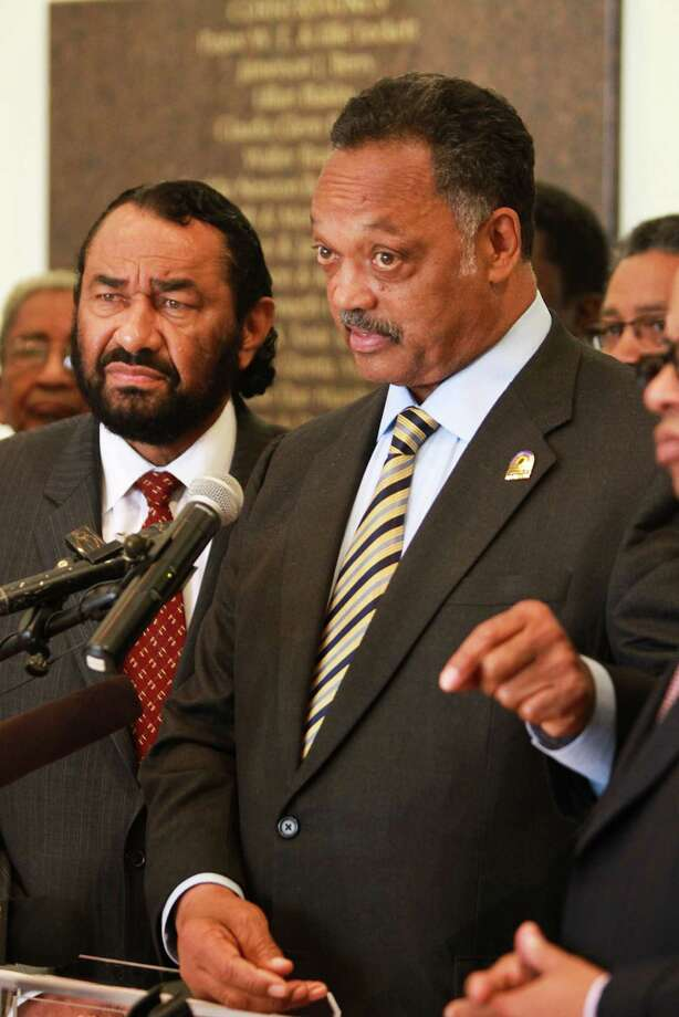 The Rev. Jesse Jackson, along with Houston Congressman Al  Green, speaks out against the type of self-defense laws that are now being debated in the wake of the Trayvon Martin killing. Photo: Nick De La Torre / © 2012  Houston Chronicle