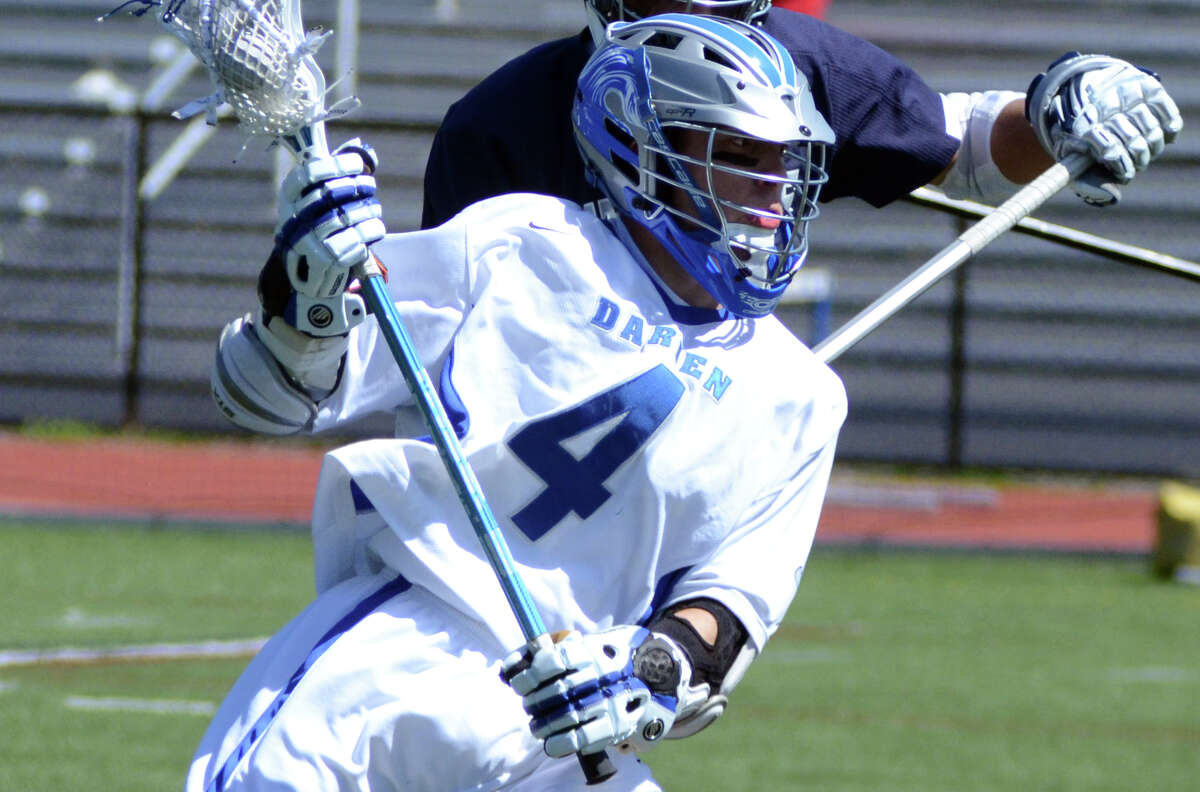 Darien's Case Matheis (4) controls the ball during the boys lacrosse game against Staples at Darien High School on Saturday, Apr. 7, 2012.