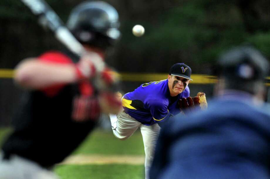 Voorheesville's Kevin Connelly (15), center, pitches during their baseball game against Chatham on Thursday, April 12, 2012, at  Roger Keenholts Park in Guilderland, N.Y. (Cindy Schultz / Times Union) Photo: Cindy Schultz / 00017218A