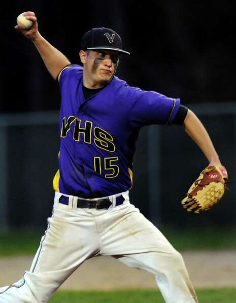 Voorheesville's Kevin Connelly (15), center, pitches during their baseball game against Chatham on T